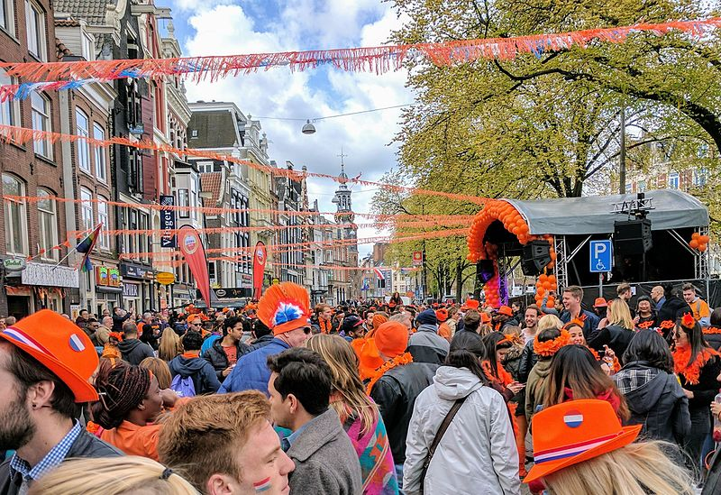 People celebrating Kingsday in Amsterdam on April 27th. The country turns orange this day, as it does with every National celebration.