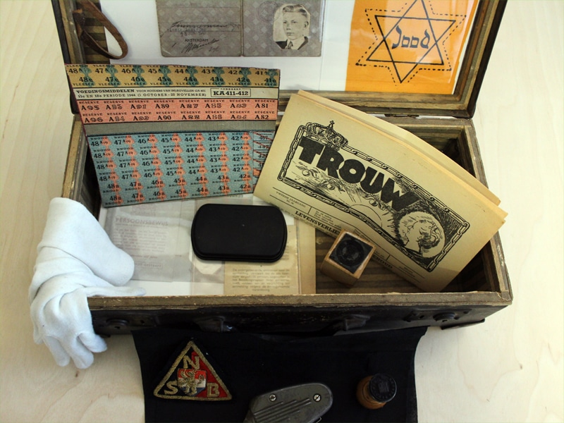 Suitcase provided for a Jewish kid with ration coupons, a Jewish newspaper, and a Jewish star that must be worn at all times.