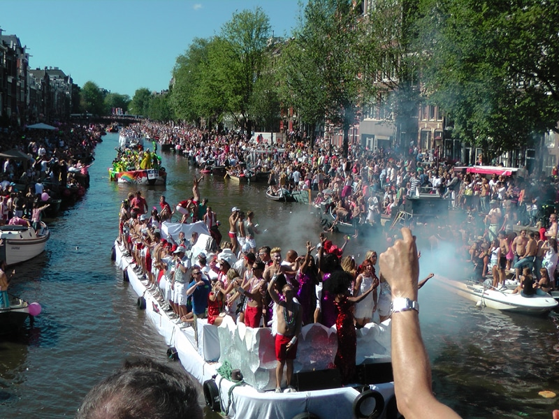 Boats on the canals during the Canal Parade in Amsterdam