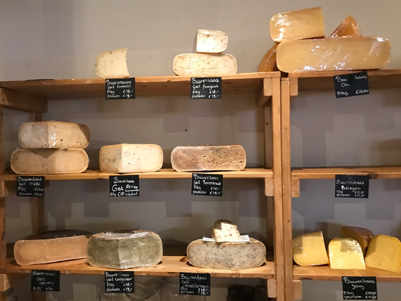 Shelf with cheeses in cheese shop Booij kaasmakers in Fenix Food Factory Rotterdam.