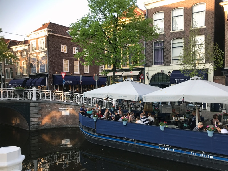 Terrace on top of a boat in a Canal in Delft.