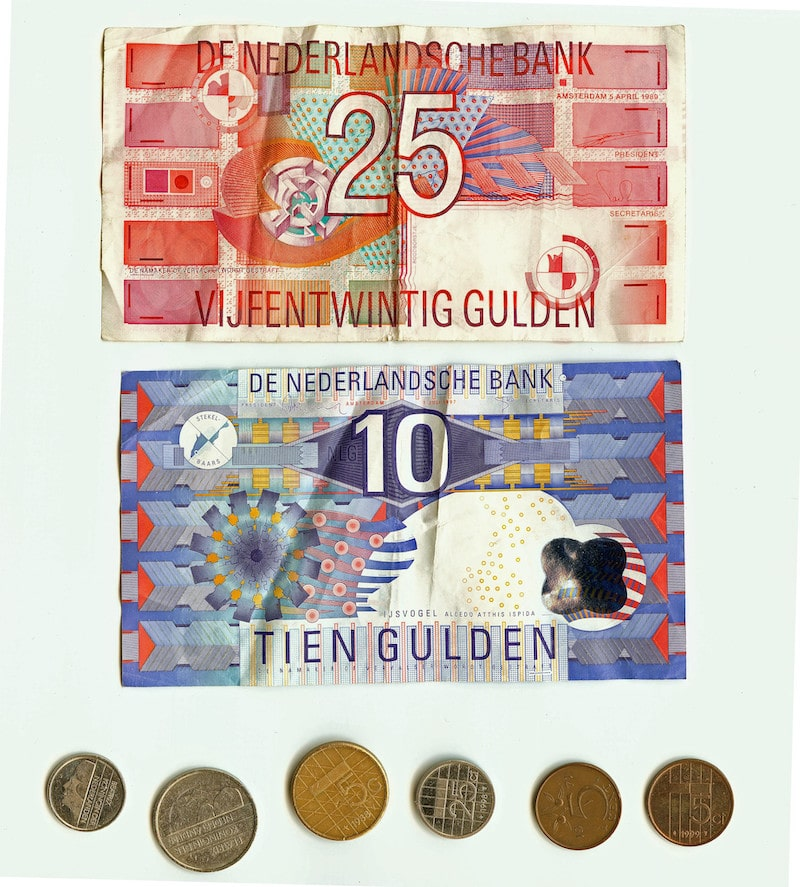 Dutch Guilder banknotes and coins.