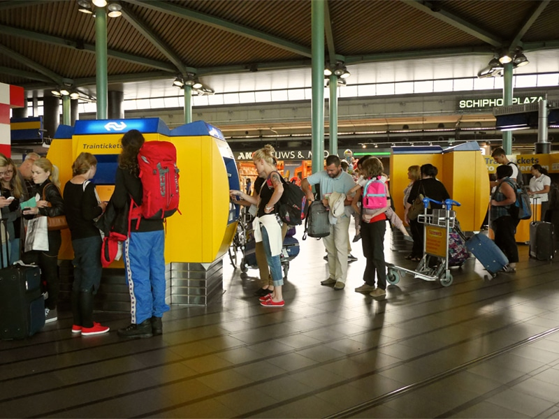 Line at Ticket Machines NS Schiphol Airport Train Station.